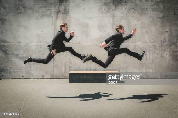 running wild, twin business porträt - geschwindigkeit stock-fotos und bilder