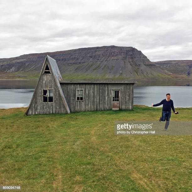 running with joy, the beauty of the westfjords - westfjords iceland stock photos and pictures