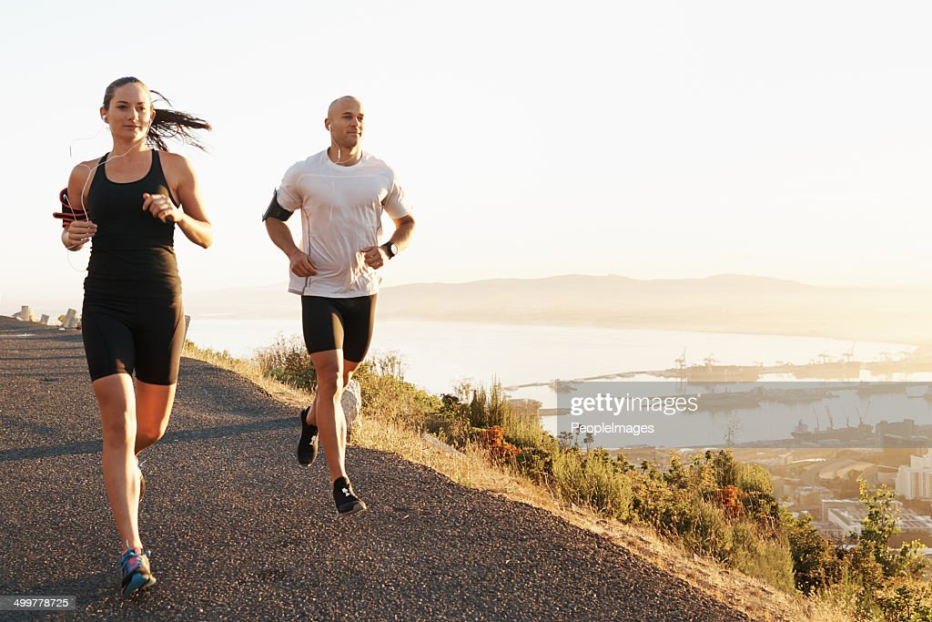 Running with music and a friend : Stock Photo