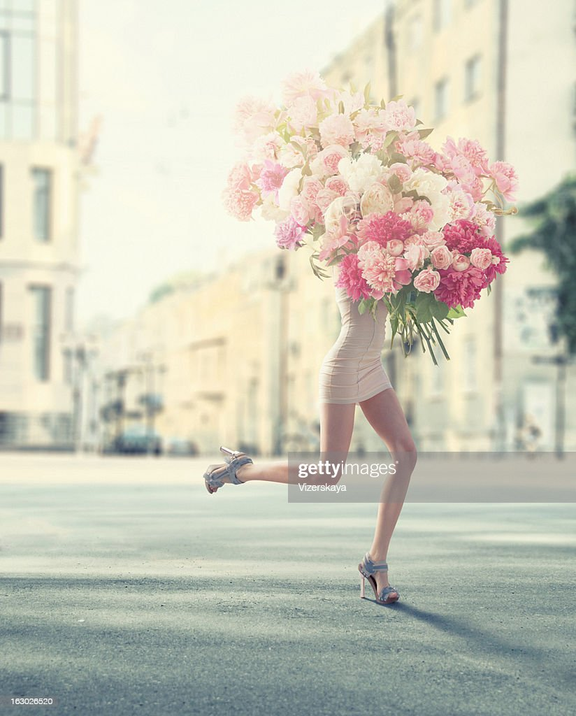 running women with giant bunch of flowers : Stock Photo