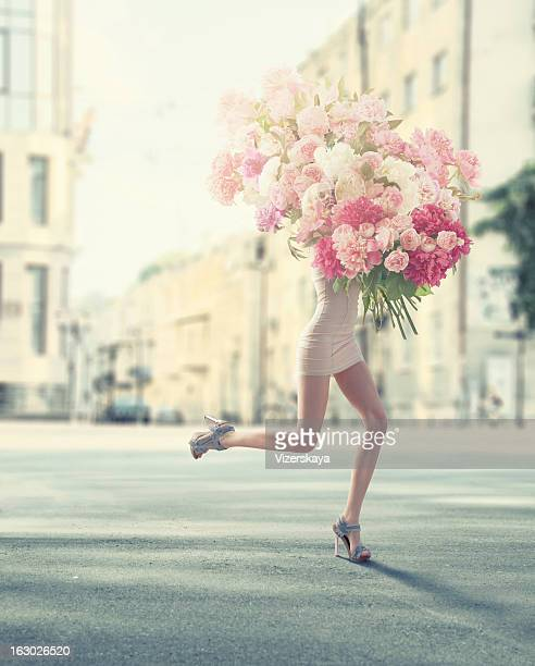 running women with giant bunch of flowers - bunch stock pictures, royalty-free photos & images