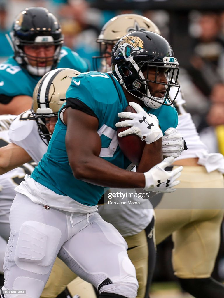 Runningack Leonard Fournette #27 of the Jacksonville Jaguars on a running play during a preseason game against the New Orleans Saints at TIAA Bank Field on August 9, 2018 in Jacksonville, Florida. The Saints defeated the Jaguars 24 to 20.