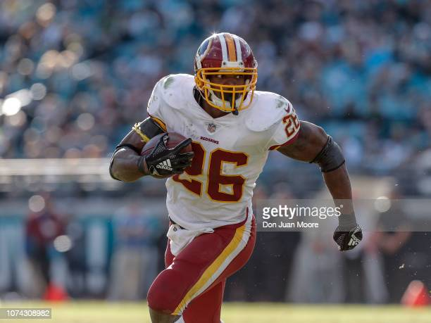 Runningback Adrian Peterson of the Washington Redskins on a running play during the game against the Jacksonville Jaguars at TIAA Bank Field on...