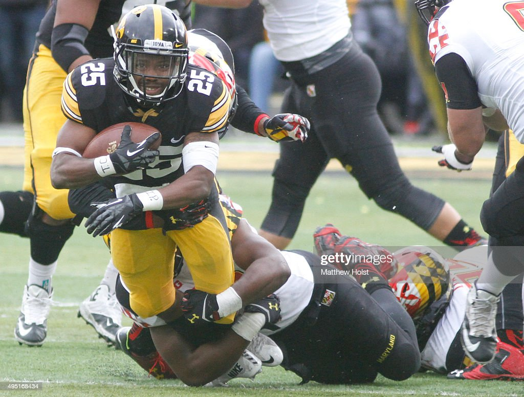 Runningback Akrum Wadley #25 of the Iowa Hawkeyes is brought down by defensive back A.J. Hendy #19 of Maryland Terrapins in the second half on October 31, 2015 at Kinnick Stadium, in Iowa City, Iowa.