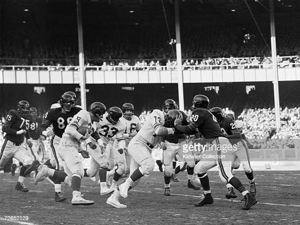 Runningback Alex Webster of the New York Giants carries the ball for a first down in the second period of the NFL Championship Game against the...