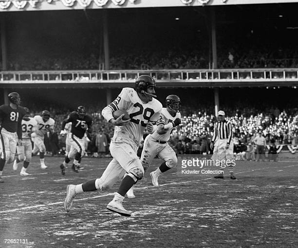 Runningback Alex Webster of the New York Giants runs for a large gain after catching a pass from quarterback Charlie Conerly during the NFL...