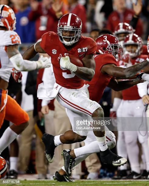 Runningback Bo Scarbrough of the Alabama Crimson Tide on a running play during the 2017 College Football Playoff National Championship Game against...