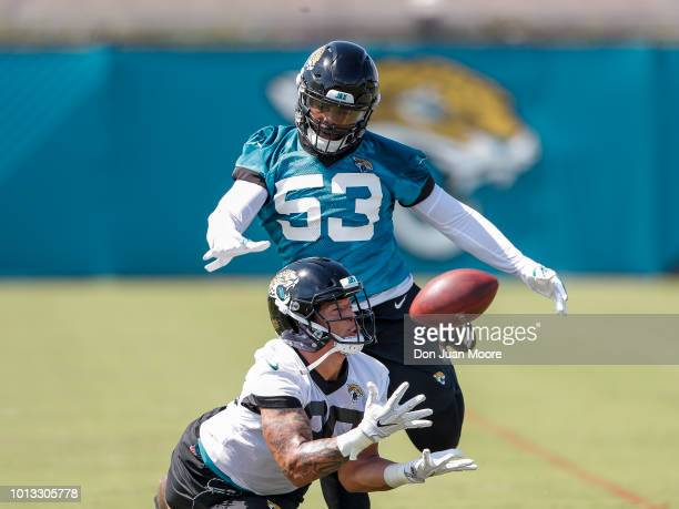 Runningback Brandon Wilds makes a catch over Linebacker Blair Brown of the Jacksonville Jaguars during Training Camp at Dream Finders Homes Practice...