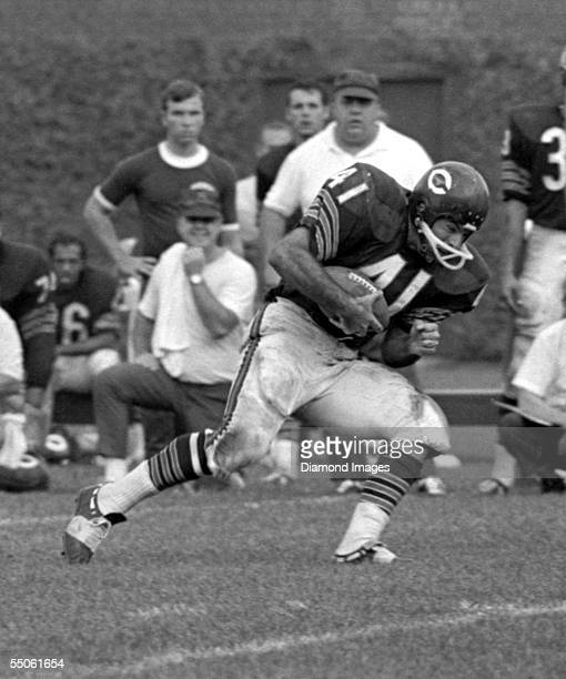 Runningback Brian Piccolo of the Chicago Bears runs the ball during a game on September 15 1968 against the Washington Redskins at Wrigley Field in...