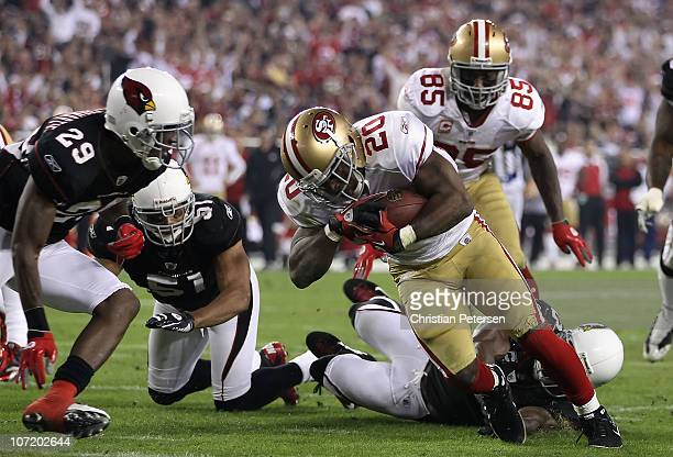 Runningback Brian Westbrook of the San Francisco 49ers carries the football on a 8 yard rushing touchdown against Dominique RodgersCromartie of the...