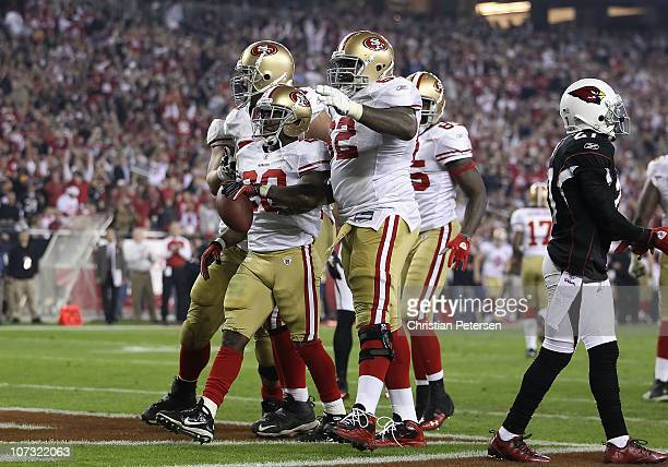Runningback Brian Westbrook of the San Francisco 49ers celebrates with teammates after scoring on a 8 yard rushing touchdown against the Arizona...