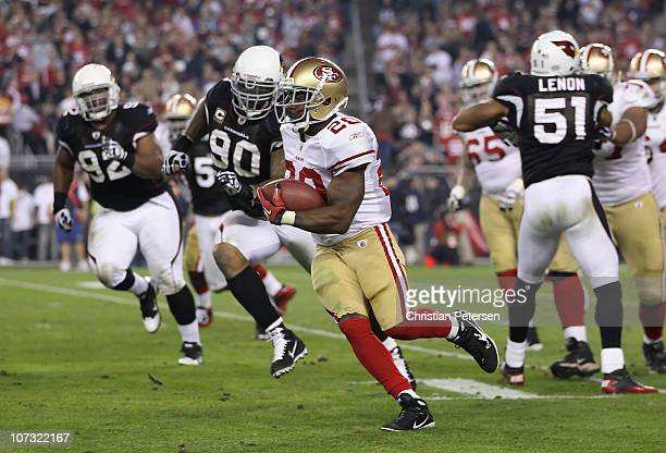 Runningback Brian Westbrook of the San Francisco 49ers runs with the football against the Arizona Cardinals during the NFL game at the University of...