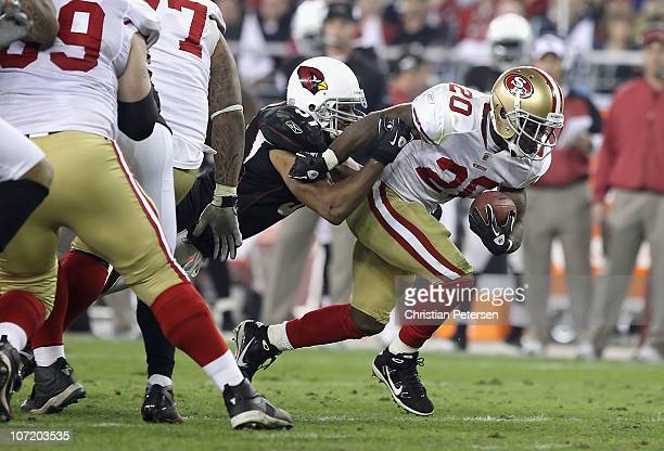 Runningback Brian Westbrook of the San Francisco 49ers rushes the football against the Arizona Cardinals during the NFL game at the University of...