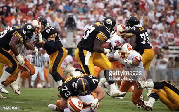 Runningback Bryon Barn Morris of the Pittsburgh Steelers gaines a few extra yards running at Tampa Stadium for a NFL game against the Tampa Bay...