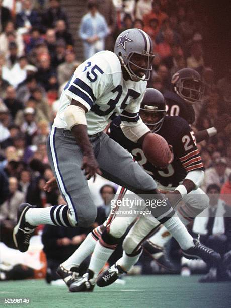 Runningback Calvin Hill#35 of the Dallas Cowboys runs the ball during a game on September 16 1973 against the Chicago Bears at Soldier Field in...