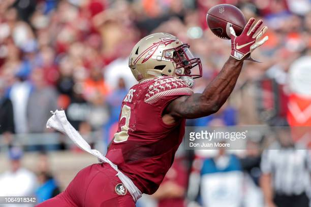 Runningback Cam Akers of the Florida State Seminoles makes a one handed catch for a touchdown during the game against the Florida Gators at Doak...