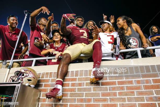 Runningback Cam Akers of the Florida State Seminoles with family and friends in the stands after the game against the North Carolina State Wolfpack...