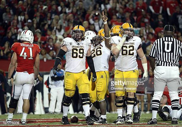 Runningback Cameron Marshall of the Arizona State Sun Devils celebrates after scoring a 2 yard rushing touchdown against the Arizona Wildcats during...
