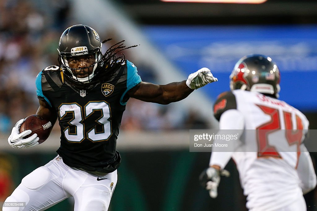 Runningback Chris Ivory #33 of the Jacksonville Jaguars avoids a tackle by Cornerback Brent Grimes #24 of the Tampa Bay Buccaneers during a preseason game at EverBank Field on August 20, 2016 in Jacksonville, Florida. The Bucs defeated the Jags 27 to 21.