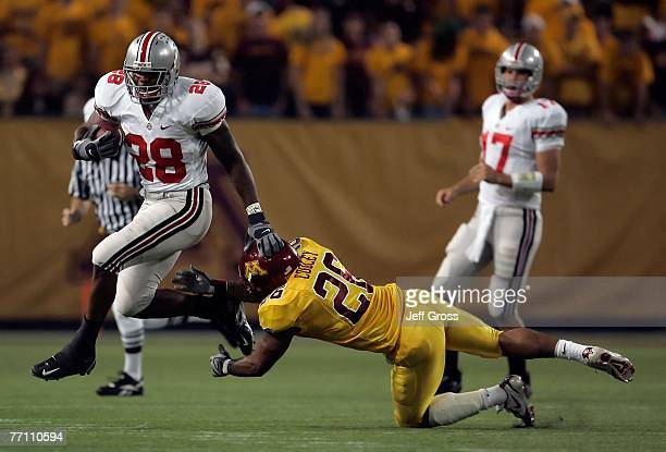 Runningback Chris Wells of the Ohio State Buckeyes breaks the tackle of Duran Cooley of the Minnesota Golden Gophers in the second quarter at the...