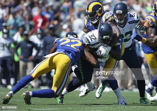 Runningback Christine Michael of the Seattle Seahawks gets stopped by Trumaine Johnson and William Hayes of the Los Angeles Rams during the second...