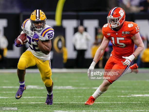 Runningback Clyde EdwardsHelarie of the LSU Tigers on a running play trys to avoids a tackle by Linebacker Jake Venables of the Clemson Tigers during...