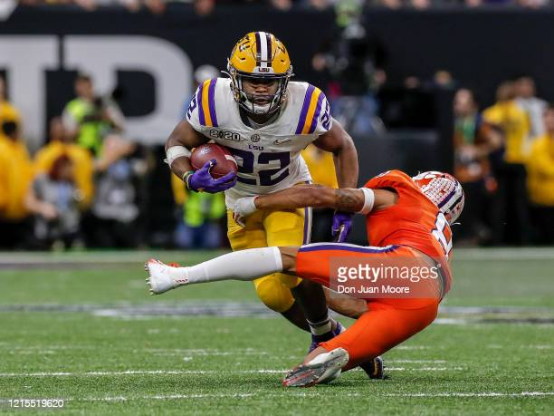 Runningback Clyde EdwardsHelarie of the LSU Tigers on a running play avoids a tackle by Cornerback AJ Terrell of the Clemson Tigers during the...