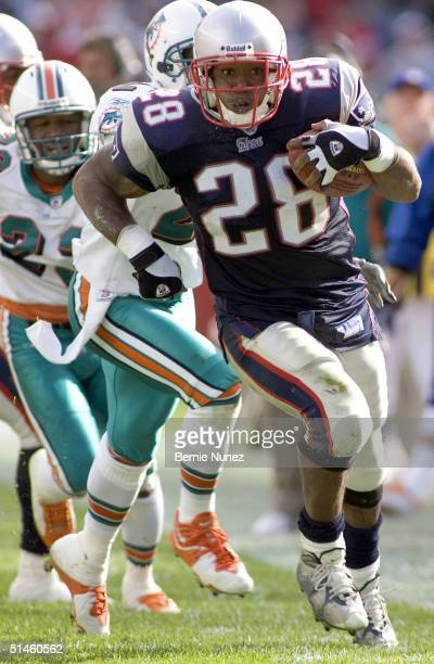 Runningback Corey Dillon of the New England Patriots gains 36 yards on this run in the third quarter of the game against the Miami Dolphins at...