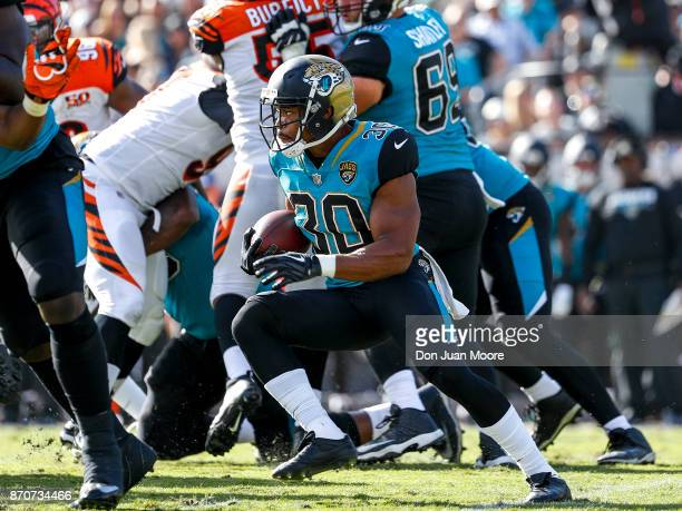 Runningback Corey Grant of the Jacksonville Jaguars on a running play during the game against the Cincinnati Bengals at EverBank Field on November 5...