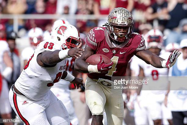 Runningback Dalvin Cook of the Florida State Seminoles on a running play during the game against the North Carolina State Wolfpack at Doak Campbell...