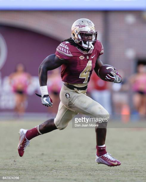 Runningback Dalvin Cook of the Florida State Seminoles on a running play during the game against the North Carolina Tar Heels at Doak Campbell...