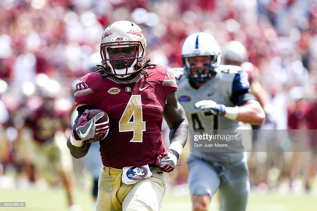 Runningback Dalvin Cook #4 of the Florida State Seminoles on a runs in for a score during the game against the Charleston Southern Buccaneers at Doak Campbell Stadium on Bobby Bowden Field on September 10, 2016 in Tallahassee, Florida. The 3rd ranked Florida State defeated Charleston Southern 52 to 8.