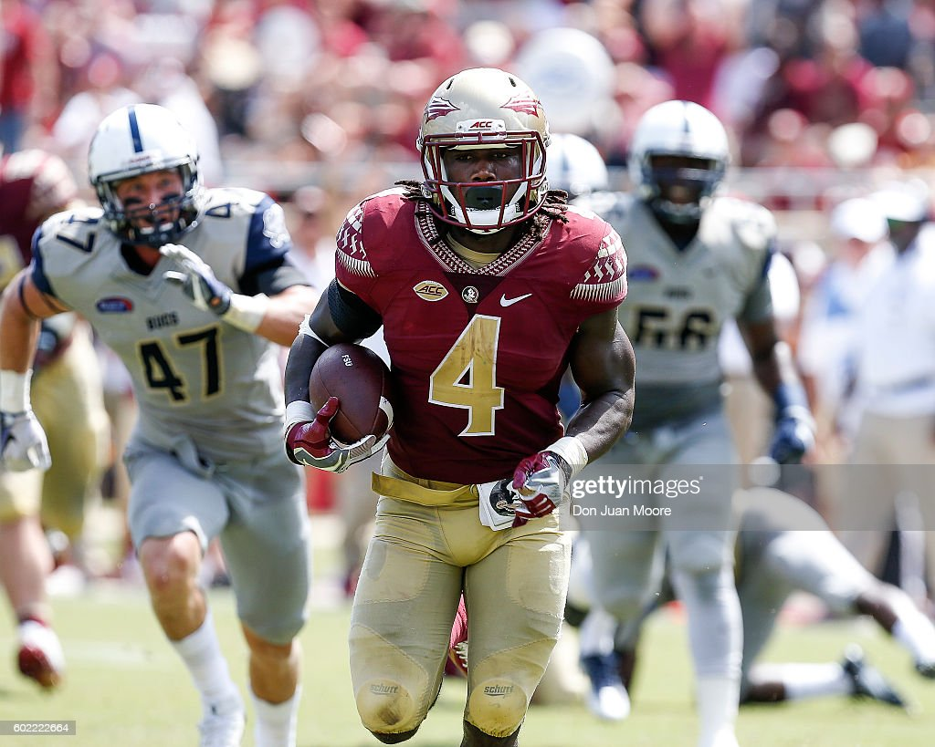 Runningback Dalvin Cook #4 of the Florida State Seminoles runs in for a score during the game against the Charleston Southern Buccaneers at Doak Campbell Stadium on Bobby Bowden Field on September 10, 2016 in Tallahassee, Florida. The 3rd ranked Florida State defeated Charleston Southern 52 to 8.