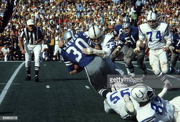 Runningback Dan Reeves of the Dallas Cowboys is stopped by linebacker Mike Curtis of the Baltimore Colts during Super Bowl V on January 17 1971 at...