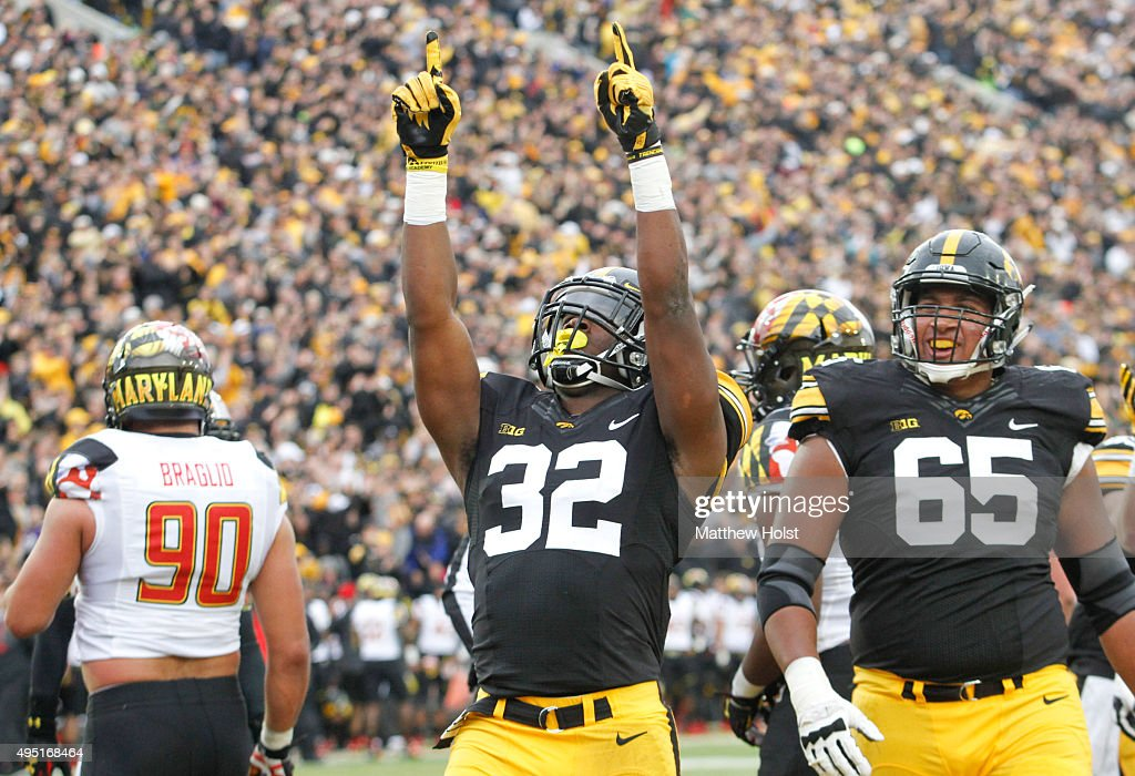 Runningback Derrick Mitchell Jr. #32 of the Iowa Hawkeyes celebrates after a touchdown in the first half against the Maryland Terrapins on October 31, 2015 at Kinnick Stadium, in Iowa City, Iowa.