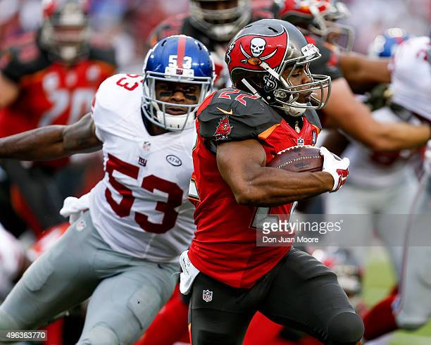 Runningback Doug Martin of the Tampa Bay Buccaneers avoids a tackle by Linebacker Jasper Brinkley of the New York Giants during the game at Raymond...
