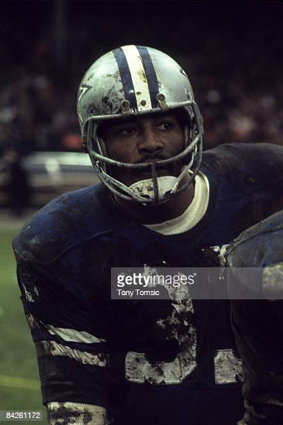Runningback Duane Thomas of the Dallas Cowboys watches the action from the sidelines during a game on December 12, 1970 against the Cleveland Browns...
