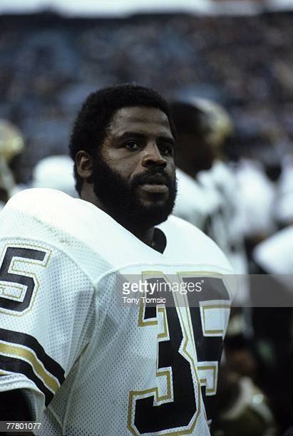 Runningback Earl Campbell of the New Orleans Saints watches the action from the sidelines during a game on October 28 1984 against the Cleveland...