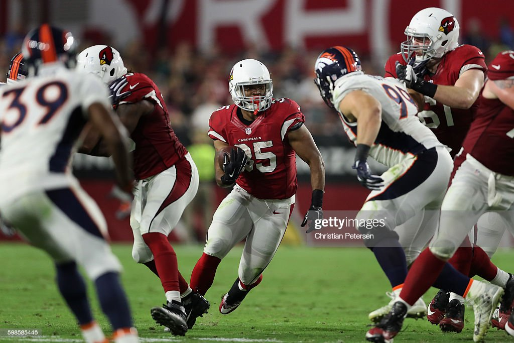 Runningback Elijhaa Penny #35 of the Arizona Cardinals rushes the football against the Denver Broncos during the preseaon NFL game at the University of Phoenix Stadium on September 1, 2016 in Glendale, Arizona. The Cardinals defeated the Broncos 38-17.