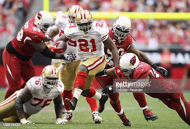 Runningback Frank Gore of the San Francisco 49ers breaks away to score on a 37 yard rushing touchdown against the Arizona Cardinals during the third...