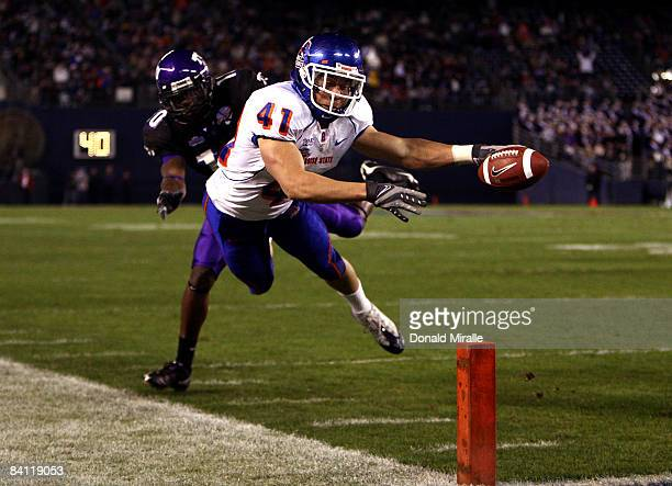 Runningback Ian Johnson of the Boise State Broncos dives for the endzone pilon against the defense of Cornerback Rafael Priest of TCU during the San...