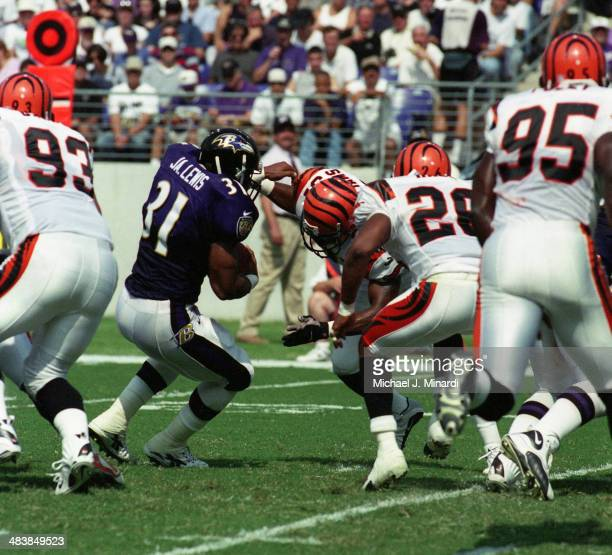 Runningback Jamal Lewis of the Baltimore Ravens breaks through the line for a few extra yards during an NFL game against the Cincinnati Bengals at...