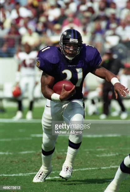 Runningback Jamal Lewis of the Baltimore Ravens carries the ball for a few extra yards during a NFL game against the Cincinnati Bengals at PSINet...