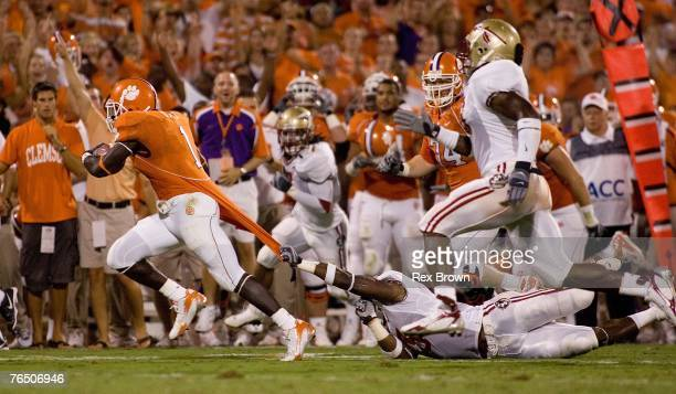 Runningback James Davis of the Clemson Tigers drags Myron Rolle of the Florida State Seminoles during the first half on September 3 2007 in Clemson...