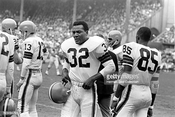 Runningback Jim Brown of the Cleveland Browns awaits the next series of plays for the offense during a game on November 15 1964 against the Detroit...