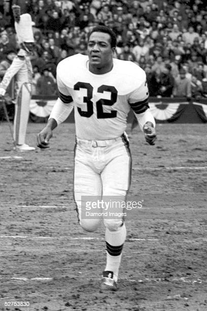 Runningback Jim Brown of the Cleveland Browns is announced onto the field prior to the NFL Championship Game on December 27 1964 against the...