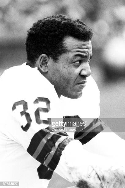 Runningback Jim Brown of the Cleveland Browns on the bench during a game in 1964 at Municipal Stadium in Cleveland Ohio