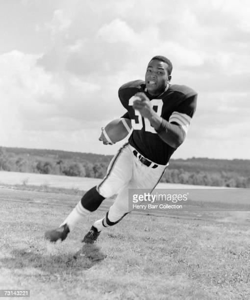 Runningback Jim Brown of the Cleveland Browns poses for an action portrait during training camp in July 1957 at Hiram College in Hiram Ohio This...