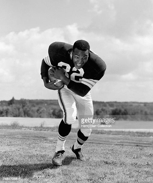 Runningback Jim Brown of the Cleveland Browns poses for an action portrait during training camp on July 24 1957 at Hiram College in Hiram Ohio