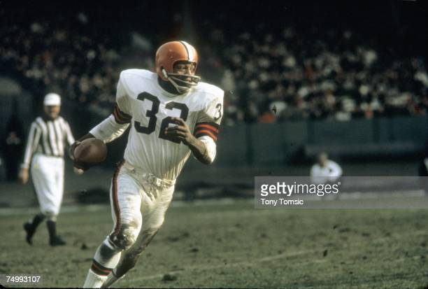 Runningback Jim Brown of the Cleveland Browns runs with the ball during a game in the 1960's at Municipal Stadium in Cleveland Ohio